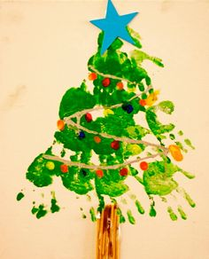 Handprint Christmas Tree Hanging - super simple christmas gift for parents.  Great for preschool & elementary school teachers.  Uses are endless (pillow, wall hanging, t-shirt, etc). Happy Crafting ~ Sheril #christmas #handprint #teacher