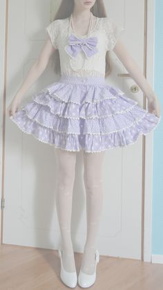 Very lovely doll inspired outfit with the lilac ruffled skirt, the white blouse and the lilac bow around the neck.