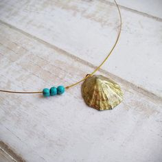 This Dainty Golden Sea Shell Necklace is handmade with love from Greece. This elegant summer necklace consists of a natural limpet shell pendant, personally collected from my favorite family beach in Greece, hand painted with golden acrylic paint and adorned with blue howlite gems. All components Seashell Necklace, Bridal Necklace, Shell Necklaces, Shell Pendant, Gold Pendant, Greek Design, Summer Necklace, Steel Chain, Gold Paint