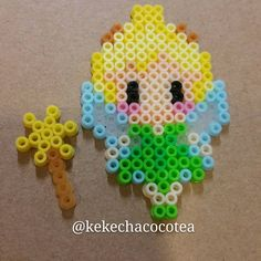 Tinker Bell perler beads by kekechacocotea Perler Bead Designs, Easy Perler Bead Patterns, Melty Bead Patterns, Hama Beads Design, Diy Perler Beads, Perler Bead Art, Beading Patterns, Hama Beads Kawaii, Peyote Patterns