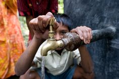 Clean drinking water from a pond sand filter system in Bangladesh.    20 dollars can provide one person with clean, safe drinking water.