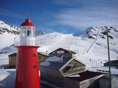 Andermatt Lighthouse in the snowbound Oberalp Pass. Located in the Swiss Alps, the lighthouse serves no actual function aside from being a topic of conversation for visitors. It is however the highest lighthouse in the world.