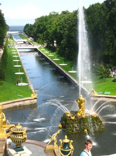 RUSSIA. St. Petersburg. View from the Winter Palace, Peterhof, to the Baltic sea, through the golden statues fountain.