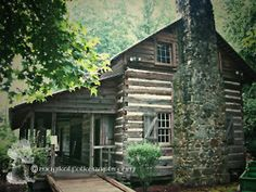 log cabin...I wish I had a log cabin on a river somewhere - as a vacation home....