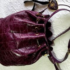 Croc Imprinted Leather Cross Body Bucket Bag Amethyst croc imprinted leather cross body bag. EUC. Super clean inside and out. Side drawstring with tassel. 2nd pic truly represents the color☺️ Danielle Nicole Bags Crossbody Bags