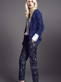 Model wears Naughty Dog tricot cardigan, viscose shirt and jacquard trousers with lurex effect.