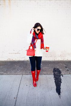 ivory cabled tunic sweater + red plaid scarf + dark skinny jeans + red Hunter wellies