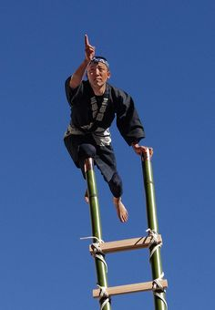 Hashigo Balancing Act, Dezome-shiki: A fireman performs the hashigo (ladder) acrobatics of an Edo-period (1603-1868) fire fighter. This is part of a dezomeshiki New Year's ceremony in Japan.