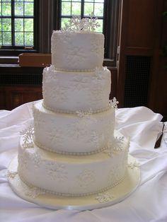 winter wedding cakes   Winter wedding cake w/ buttercream icing w/ royal icing snowflakes.