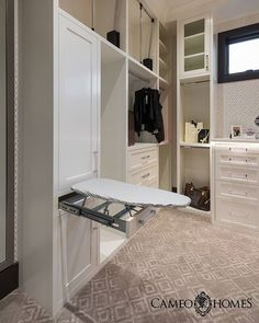 This Master Closet includes a built-in ironing board. #cameohomesinc #utahhomes #Utah #closet #walkincloset #storage #wallpaper #cabinetry #cabinets #utahgram #igutah #wowutah #hgtv #housebeautiful #houzz #interiordesign #carpet #sitamontgomeryinteriors #the_real_houses_of_ig  PC: @lucycall