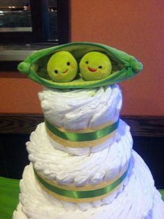 Diaper cake topper made from three peas in a pod toy story 3 toy... Found it on amazon and took out a pea to make it two peas in a pod