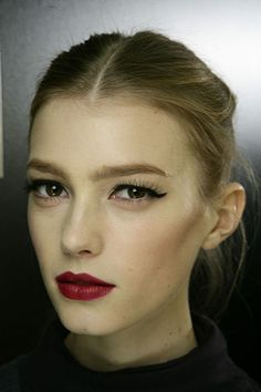 delicate wings and bold red lips