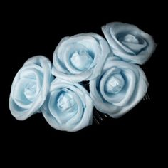"""This bold and stylish floral hair comb is a perfect addition to your perfectly coiffed bridal up-do. Five of these silk-inspired tea roses are fastened securely to a hair comb. This piece will add a touch of floral elegance to any themed wedding.  Size: Adornment measures 5"""" wide x 3.5"""" tall on a 1.5"""" comb"""