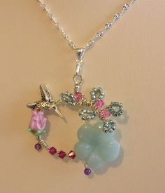 Hummingbird Song Necklace - Sterling silver wire necklace with chain, lampwork bead, genuine gemstone, Swarovski Crystal, amethyst, glass seed beads, and pewter hummingbird. www.artisme.com