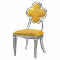 """Add a pop of color to your dining table or living room seating group with this eye-catching side chair, showcasing a flower-shaped back and silver leaf finish.     Product: Chair  Construction Material: Wood, foam and fabric  Color: Yellow and silver Features:Flower-shaped backCurved back legs Dimensions:  38"""" H x 18"""" W x 21"""" D"""