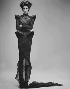 Sculptural Fashion - dress with bold 3D contours; elegant futuristic fashion photography