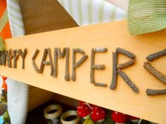 Camping party - sign made out of twigs!