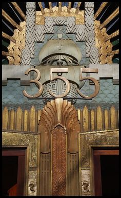 Amazing Art Deco Door!  I See A Sunburst, A Ship Reminiscent Of The Old Spanish Sailing Ships, And Further Down A Couple Of Seahorses.  Really Cool!
