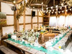 A #vintage farm-inspired reception with rustic decor and pops of yellow and turquoise. #wedding Image © The Wedding Cut
