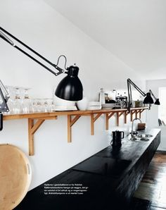 black cabinets, great lighting and simple shelves for storage.