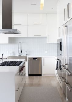 Modern White Kitchen Love white and gray tones and contrast with wood floor