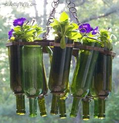 s 15 incredible backyard ideas using empty wine bottles, gardening, outdoor living, repurposing upcycling, Use a few bottles as a planter chandelier Empty Wine Bottles, Recycled Wine Bottles, Wine Bottle Crafts, Bottles And Jars, Bottle Art, Wine Bottle Trees, Wine Bottle Holders, Garden Care, Outdoor Chandelier