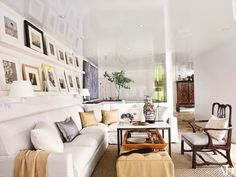 Vicente Wolf and Matthew Yee renovated and redecorated their beach house in Montauk, NY. The living room was painted in Vicente Wolf White from PPG Voice of Color.