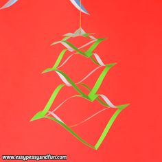 You will love how simple and gorgeous these hanging paper Christmas decorations are.