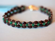 Beadwoven bracelet of Fire Polished Crystals and Pinch Beads in the color pictured. Accented with seed beads. Dainty, easy to wear bracelet.