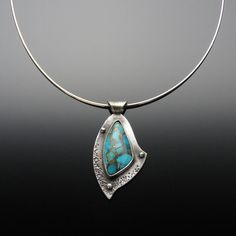 'Altruism' Turquoise Metal Matrix and Sterling Silver Pendant  Turquoise is a good general healer for all illnesses. This gentle, cool, soothing stone is a Native American classic. It is used for healing on every continent. It also brings about prosperity. Turquoise is considered to be a symbol of generosity, sincerity, and affection.