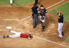 Scary scene -  Arizona Diamondbacks outfielder David Peralta lays on the ground after being hit in the head by a pitch in the sixth inning as Miami Marlins pitcher Jose Fernandez reacts at Chase Field on July 22 in Phoenix. Peralta left the game and passed initial concussion protocol. -  © Mark J. Rebilas/USA TODAY Sports