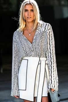 Now this is how you mix graphic pieces this season! Try a black and white blouse with an abstract print, unbuttoned just so and tuck it into a skirt with contrasted piping. It's a major plus if it's asymmetrical or has a tie-front detail as we see here.