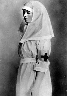 Grand Duchess Olga as a Red Cross nurse during WWI.  Love the way nurse uniforms back then looked like nuns' habits.