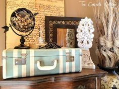 Old Suitcase painted in Duck Egg Blue with Old White stripes. Gotta love Annie Sloan Chalk Paint!!