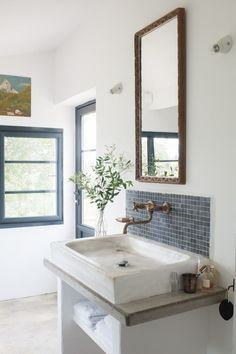Bathroom with brass sink faucet at Mas Maroc, Amanda Pays Corbin Bernsen farmhouse in the South of France. Tim Beddow photo from Open House.