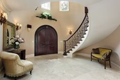 50 Traditional Style Foyer Ideas (Photos) This circular foyer has beige walls a. 50 Traditional Style Foyer Ideas (Photos) This circular foyer has beige walls and a winding stairc Foyer Decorating, Tuscan Decorating, Decorating Ideas, Entrance Foyer, Grand Entrance, Wooden Door Design, Wooden Doors, Modern Foyer, Small Sitting Areas
