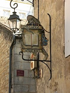 Saint Emilion - not just wine - A Writer's Site. Metal Signage, Just Wine, Saint Emilion, Pub Signs, Shop Fronts, Street Lamp, Photography Gallery, Store Signs, Book Nooks