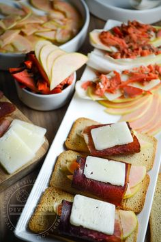 Stunning Pink Pearl apples add brightness (both in terms of colour and flavour) to a charcuterie platter with smoked salmon, bison bresaola, endive, and manchego cheese.  The post also has tips on how to assemble and balance charcuterie plates in order to get the best flavour pairings you can. #charcuterie #appetizers #sharedplates