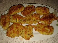 ΥΛΙΚΑ2 φλυτζάνια του τσαγιού βρασμένο ρύζι καρολίνα1 φρέσκο κρεμμυδάκι ψιλοκομμένο2 βρασμένα καρότα2 βρασμένες πατατες2 φέτες ψωμί του τοστ, χτυπημένες στο μούλτι150 γραμμάρια τρμμένο κασέρι1 αυγό 3 φέτες ψιλοκομμένη γαλοπούλαΑλάτιΠιπέριΡίγανηΜαϊντανός2 κουταλιές της σούπας ελαιόλαδοΔιαδικασία• Ανακ