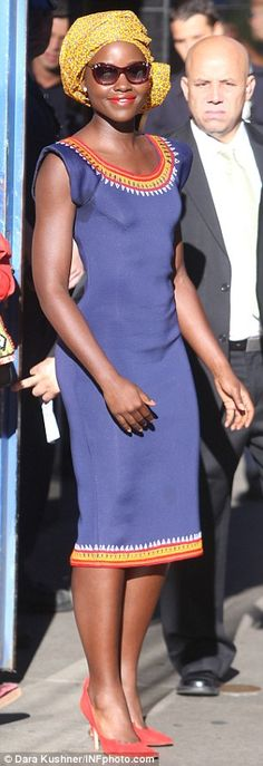 So chic: The Oscar winner wore a blue, cap-sleeved shift dress that fitted her slender figure perfectly and an African style, bright yellow head wrap plus red suede shoes