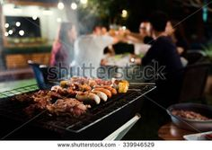 Dinner party, barbecue and roast pork at night - stock photo