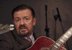 Watch: Ricky Gervais Bring David Brent Back to The Office in First Trailer for 'Life on the Road'