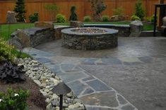 Cool firepit.  I like the idea of a gas firepit. And how nicely it is landscaped everywhere!!