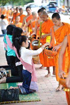 Lamas, Luang Prabang. Monks collecting alms, a beautiful sight.