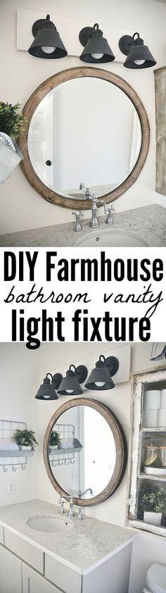 Love this bathroom vanity light fixture. The dark grey patina looks great against the white farmhouse bathroom decor