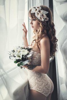 Beautiful wedding day boudoir photograph.  Photo by Maxim Guselnikov