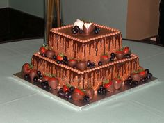 Chocolate Drip Grooms Cake All bc, with chocolate covered strawberries and dark purple grapes Chocolate Grooms Cake, Chocolate Drip, Fishing Wedding Cakes, Fishing Cakes, Beautiful Cakes, Amazing Cakes, Grooms Cake Tables, Groom Cake, White Chocolate Strawberries