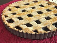 A lemon scented pasta frolla crust is filled with raspberry jam to make a beautiful breakfast crostata