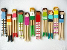 Each child Paints a Clothes Peg Person then mount in a line and box frame