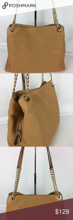 """Michael Kors Jet Set Large Shoulder Tote Condition: Gently used. Exterior in A condition. Interior good with some pen marks on flap that is not seen when bag is closed or worn   Double handles with 10"""" drop Magnetic snap closure Exterior features gold- or silver-tone hardware. Interior features a center zip compartment, 1 zip pocket and 4 slip pockets. 13"""" W x 8"""" H x 4"""" D. Only selling what is shown in photos.    Thank you for your interest! No Trades please. Michael Kors Bags Shoulder Bags"""